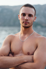 Portrait of topless muscular man
