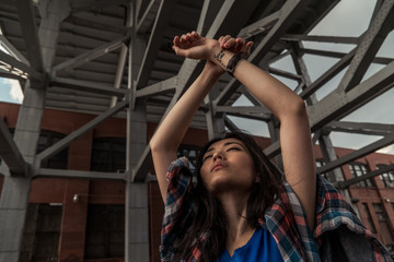 Young woman raising her hands in the air