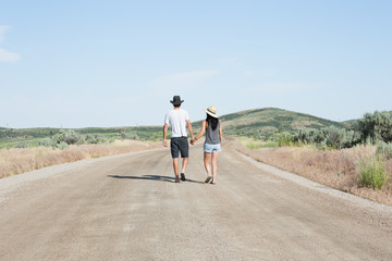 Couple Walking Down Country Road
