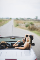 Female friends in cabriolet