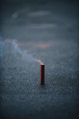 Firecracker with burning fuze
