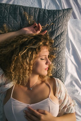 Close up of a Beautiful Blond Woman Sleeping in Bed