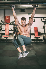 Muscular man doing chin-ups