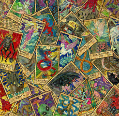 Background with colorful Tarot cards in pile. Wicca and pagan concept