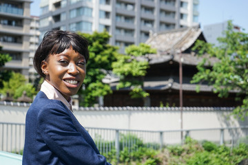 african woman doing sightseeing in Japan