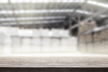 Empty old wood table in warehouse background. For montage product display