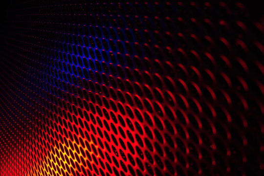 Black grid speaker texture with red and blue colors