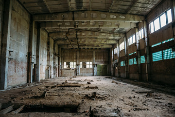 Abandoned industrial warehouse on ruined brick factory, creepy interior, perspective