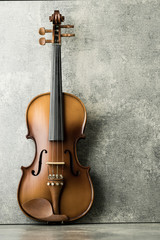 vintage violin on concrete background