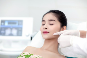Facial Laser Hair Removal. Beautician Giving Laser Epilation Treatment To Young Woman's Face At Beauty Clinic;Body Care; Hairless Smooth And Soft Skin; Health And Beauty Concept.