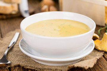 Fresh made Creamy Chanterelle Soup on a rustic background