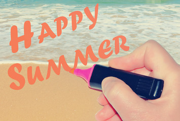 Hand writing HAPPY SUMMER at sea surf covering sand beach image background. Vacation theme. Toned colors vintage image