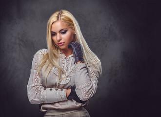 Studio portrait of old fashioned blonde.