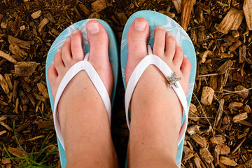 Young Girl's Bare Feet in Flip Flops