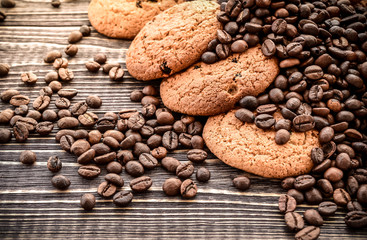 fresh Oatmeal Cookies and coffee beans on wooden background