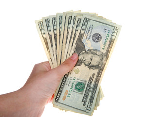 Young female hand holding stack of twenty dollar bills fanned out isolated on white background.