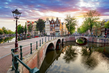 Foto op Plexiglas Amsterdam Amsterdam Canal houses at sunset reflections, Netherlands
