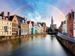 Rainbow over Canal in Bruges and famous Belfry tower,  Belgium