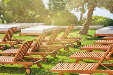 Hotel Poolside Chairs on a green meadow