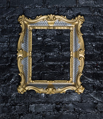 golden Victorian frame on a black brick wall