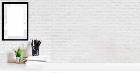 Loft workspace concept. Mock up white frame and stuff, minimal stuff on desk.