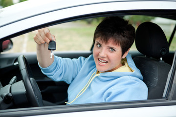 Female Driver Holds the Key of her New Car