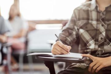 Schoolboy Taking Notes