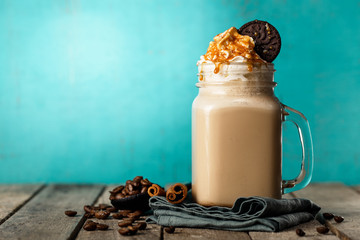Foto op Canvas Chocolade Sweet served drink on blue