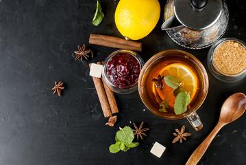 Hot tea with mint, lemon, mint and raspberry jam
