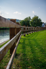 wooden fence on the edge of the lake