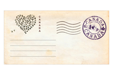 Post envelope with  Canada postage stamps and prints. Heart shape created of flying pigeons. Love Canada.  Vintage style. Isolated on a white