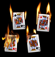 Real Burning Playing Cards with red hot Flames Isolated on Black Background: Kings