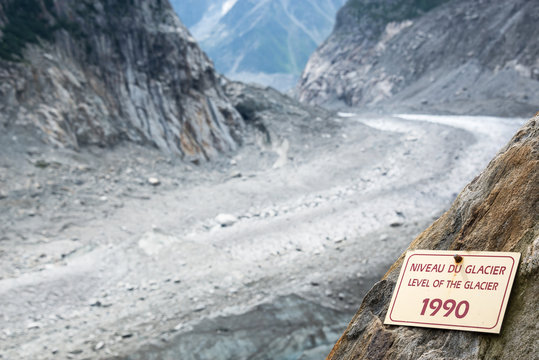 Sign indicating the level of the Glacier Mer de Glace in 1990, glacier melting illustration, in Chamonix Mont Blanc Massif, The Alps, France