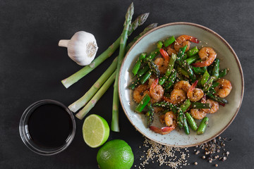 Salad with asparagus and shrimps in plate