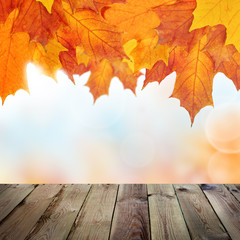 Autumn Background with Empty Wooden Table, Bokeh and Fall Maple Leaves, Vintage Outdoor Template