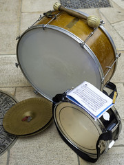Drum, cymbal and bass drum used by musicians during a religious festival. The music score is visible