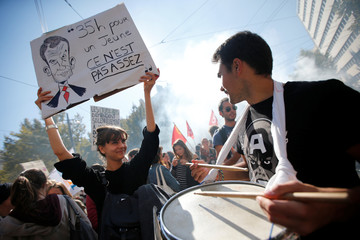 French students attend a demonstration with public sector workers as part of a nationwide strike against French government reforms in Marseille