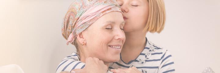 Girl hugging ill mother