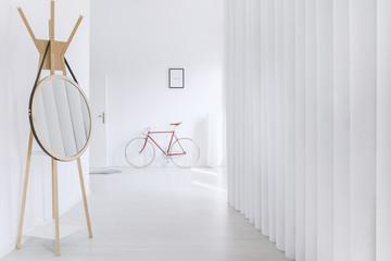 Round mirror in minimalist hall