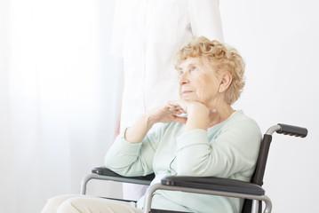 Sad pensioner in wheelchair