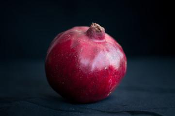 fresh pomegranate on a black background