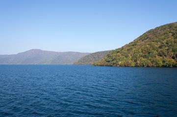 Scenic view of lake Towada with small islands, Aomori, Oirase Gorge, Japan