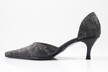 Female black and grey leather shoe on white background, isolated product.