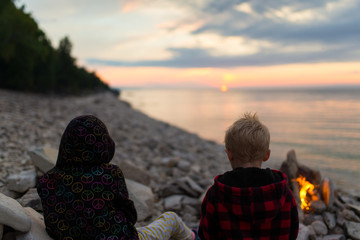 Boy and Girl Watching Sunset With Campfire Backcountry Camping at High Dump Bruce Trail Canada