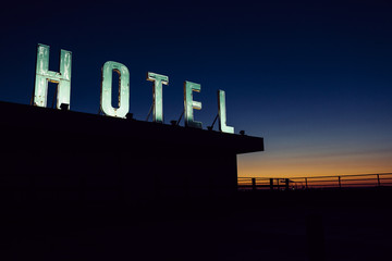Old hotel sign on a roof