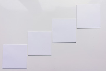 Four square sheet on a white background. Top view. Close-up