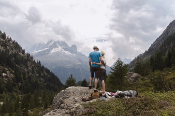 Young couple standing in front of a mountain view
