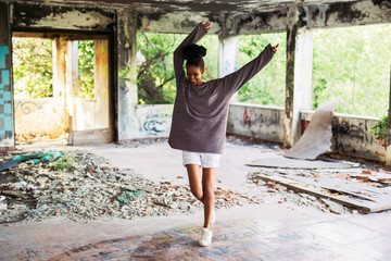 Woman with dreadlock having fun in an abandoned place