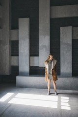 Girl standing in front of abstract wall