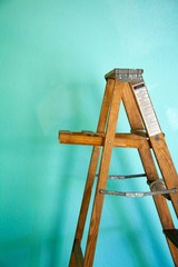 Ladder against a bright green wall